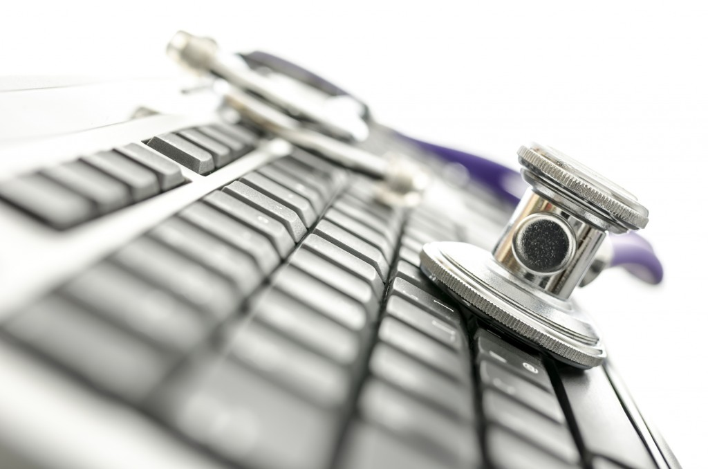 Closeup of keyboard with stethoscope